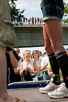 Chrissie Wellington speaks to spectators at the race start after racking her bike the day before the Challenge Roth Ironman Triathlon, Roth, Germany, 09 July 2011