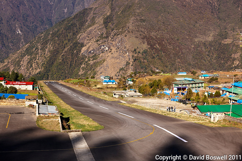 The very short runway for Lukla Airport, officially know as Tenzing-Hillary Airport.  Lukle is the start of the trek to Everest Base Camp in the Khumbu Valley, Nepal.
