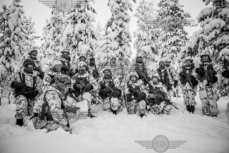 A group of Border Guards recruits in the forest during training. They will spend the night outside enduring temperatures dropping to minus 30 Celsius.