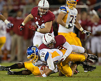 STANFORD, CA - August 31, 2012: Brent Seals on a quarterback sack during Stanford's game vs San Jose State. Stanford won 20-17.
