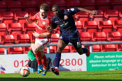 14.09.2013 Crewe, England. Crewe Alexandra defender Matt Tootle and Walsall FC forward Craig Westcarr in action during the League One game between Crewe Alexandra and Walsall FC from the Alexandra Stadium
