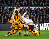 9th February 2019, Pride Park, Derby, England; EFL Championship football, Derby Country versus Hull City; Martyn Waghorn of Derby County is tackled by Liam Ridgewell of Hull City as Eric Lichaj of Hull City assists