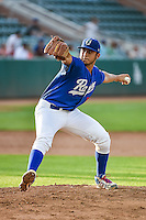Ogden Raptors starting pitcher Jairo Pacheco (11) delivers a pitch to the plate against the Great Falls Voyagers in Pioneer League action at Lindquist Field on July 16, 2015 in Ogden, Utah. Ogden defeated Great Falls 5-2. (Stephen Smith/Four Seam Images)