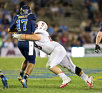 PASADENA, CA - November 24, 2012:  Stanford nose guard David Parry (58) sacks the UCLA quarterback during the Stanford Cardinal vs the UCLA Bruins at the Rose Bowl in Pasadena, CA. Final score Stanford Cardinal 34, UCLA Bruins 17.