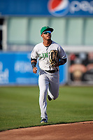 Clinton LumberKings center fielder Anthony Jimenez (5) jogs back to the dugout during a game against the West Michigan Whitecaps on May 3, 2017 at Fifth Third Ballpark in Comstock Park, Michigan.  West Michigan defeated Clinton 3-2.  (Mike Janes/Four Seam Images)