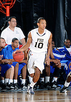 Florida International University guard Cameron Bell (10) plays against Florida Memorial University in an exhibition game .  FIU won the game 86-69 on November 9, 2011 at Miami, Florida. .