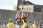 Brothers in Arms: Mikey Boyle Kerry left and Liam Boyle Kerry rises over Nicky Horan Meath