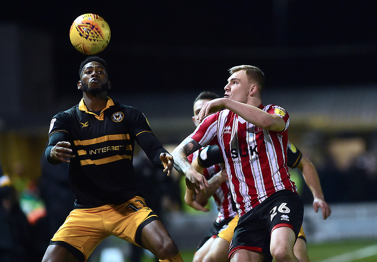 Newport County's Jamille Matt heads clear under pressure from Lincoln City's Harry Anderson<br /> <br /> Photographer Andrew Vaughan/CameraSport<br /> <br /> The EFL Sky Bet League Two - Lincoln City v Newport County - Saturday 22nd December 201 - Sincil Bank - Lincoln<br /> <br /> World Copyright © 2018 CameraSport. All rights reserved. 43 Linden Ave. Countesthorpe. Leicester. England. LE8 5PG - Tel: +44 (0) 116 277 4147 - admin@camerasport.com - www.camerasport.com