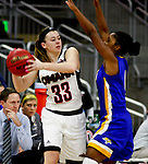 OMAHA, NE - FEBRUARY 4TH, 2016 - Remy Davenport #33 of University of Nebraska Omaha looks to pass around South Dakota State defender Alexis Alexander #1 during their game Thursday evening at Baxter Arena in Omaha, NE. (Photo By Ty Carlson/Inertia)