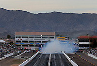 Feb 22, 2014; Chandler, AZ, USA; Overall view as NHRA funny car drivers do their burnouts during qualifying for the Carquest Auto Parts Nationals at Wild Horse Motorsports Park. Mandatory Credit: Mark J. Rebilas-USA TODAY Sports