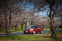 Red Dodge Caliber in Potomac park near Tidal basin D.C. during Cherry Blossom festival
