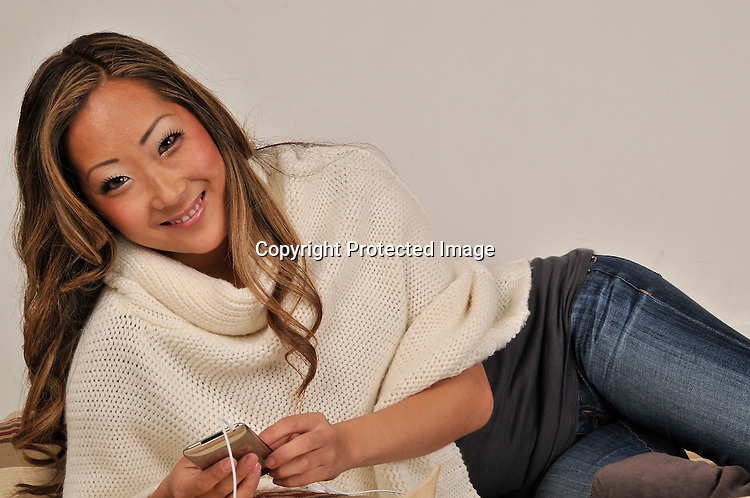 Royalty free photo of Asian woman on phone