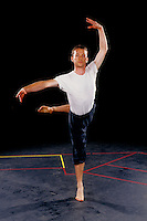 College student practicing ballet moves for rehearsal on campu