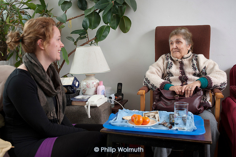 Alicia Nicolas, who has suffered a stroke, is unable to leave her flat unaided and receives regular weekly visits from volunteer Luizee Buchan, through Age Concern Camden's Good Neighbours Scheme.