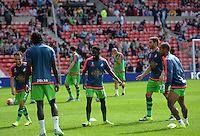 The Swansea substitutes warm up before kick off during the Barclays Premier League match between Sunderland and Swansea City played at Stadium of Light, Sunderland