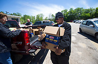 "NWA Democrat-Gazette/JASON IVESTER<br /> Marcus ""Chicago"" Hamilton helps unload donated food Thursday, May 4, 2017, at 7 Hills Homeless Center in Fayetteville. Pat Parish (left) and Billie Yates (not pictured), both with AARP, brought food that had been donated at a document shredding event on Sunday at the Washington County Fairgrounds."