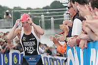 15 JUL 2007 - LORIENT, FRA - Gina Ferguson (NZL) heads for T1 at the World Elite Womens Long Distance Triathlon Championships. (PHOTO (C) NIGEL FARROW)