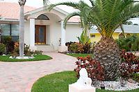 Home with manicured yard.  Belleair Beach Tampa Bay Area Florida USA
