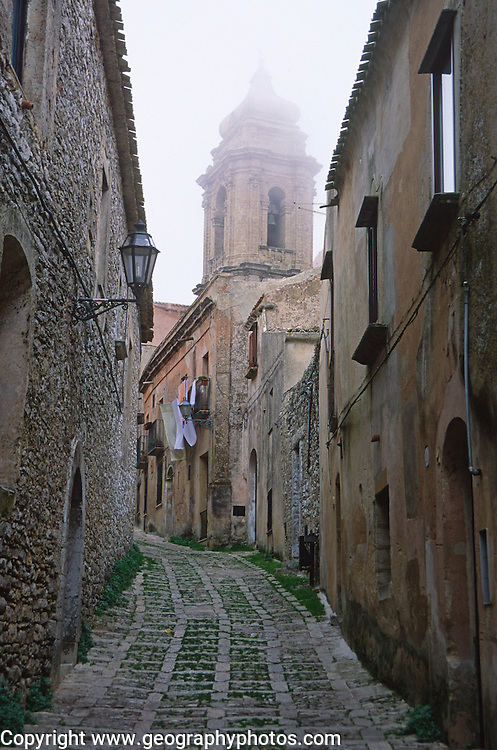 Church dome and narrow alleyway, Erice, Sicily, Italy