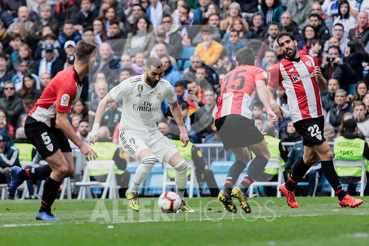 Real Madrid's Karim Benzema and Athletic Club de Bilbao's Inigo Lekue (L) and Raul Garcia (R) during La Liga match between Real Madrid and Athletic Club de Bilbao at Santiago Bernabeu Stadium in Madrid, Spain. April 21, 2019. (ALTERPHOTOS/A. Perez Meca)