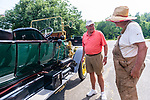 WOODBURY, CT. 16 July 2019-071619 -  Bill Parfet of Hickory Corner, Michigan, left, talks to Richard Elderkin of Middlebury, next to his 1912 Stanley Steamer, the largest passenger car built at that time as he stops for water at the Hotchkissville Firehouse off route 47 in Woodbury on Tuesday. A large group of owners of Stanley Steamers from around the country have gathered driving around the area touring the Litchfield Hills. Bill Shettle Republican-American