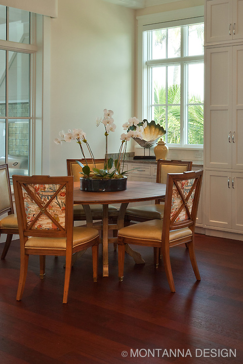 A sunlight filled breakfast nook is enhanced by the lighter wood finished and leather<br />