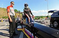 Jun. 15, 2012; Bristol, TN, USA: NHRA crew member for top fuel dragster driver Steve Torrence during qualifying for the Thunder Valley Nationals at Bristol Dragway. Mandatory Credit: Mark J. Rebilas-
