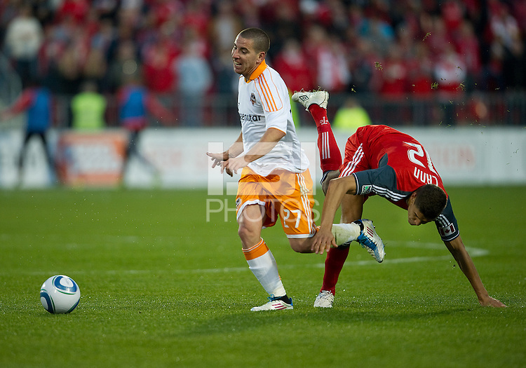 07 May2011: Houston Dynamo forward Koke #27 and Toronto FC defender Adrian Cann #12 in action during an MLS game between the Houston Dynamo and the Toronto FC at BMO Field in Toronto, Ontario..Toronto FC won 2-1.