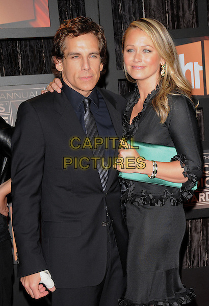 BEN STILLER & CHRISTINE TAYLOR .The 14th Annual Critics Choice Awards held at The Santa Monica Civic Center in Santa Monica, California, USA. .January 8th, 2009.half length black suit jacket green dress married husband wife jacket skirt ruffled ruffles clutch bag .CAP/DVS.©Debbie VanStory/Capital Pictures.