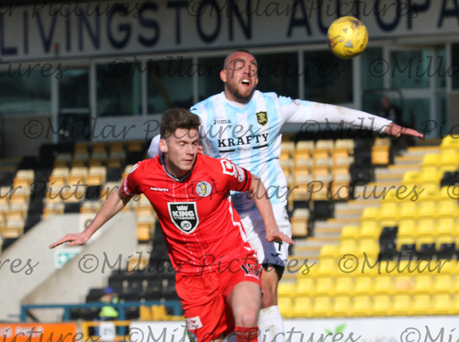 Jack Baird gets in front of Darren Cole to head in the Livingston v St Mirren Scottish Professional Football League Ladbrokes Championship match played at the Tony Macaroni Arena, Livingston on 19.3.16.