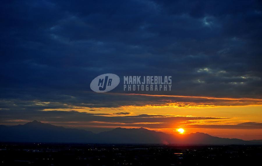 sunset sun sky clouds dusk Phoenix Arizona weather storm chaser chasing mountains
