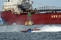 As the 266 c.i. hydro Wha Hoppen III rounds a bouy, a (Great) Lake freighter passes by on the St. Laurence Seaway.