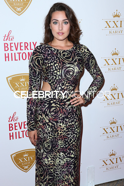 BEVERLY HILLS, CA, USA - OCTOBER 16: Kaleina Cordova arrives at the XXIV Karat Launch Party held at the Beverly Hilton Hotel on October 16, 2014 in Beverly Hills, California, United States. (Photo by Xavier Collin/Celebrity Monitor)