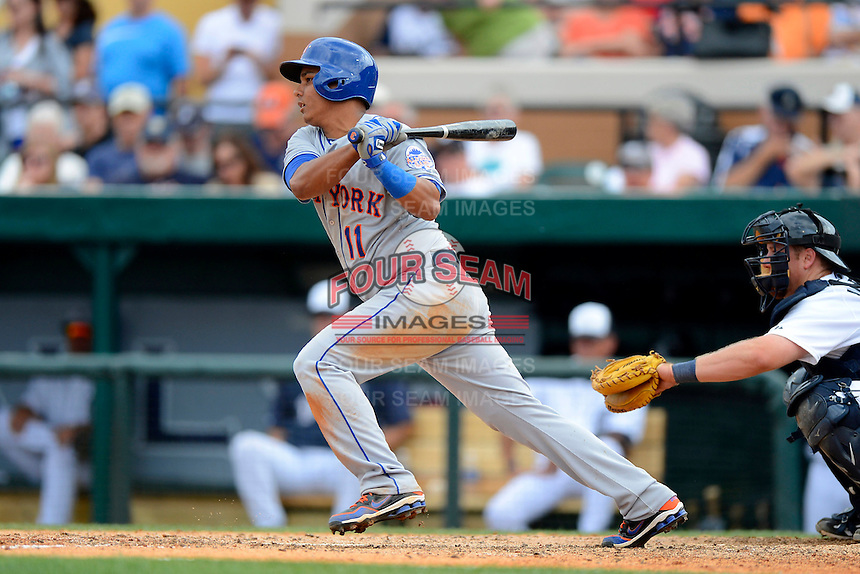 New York Mets shortstop Ruben Tejada #11 during a Spring Training game against the Detroit Tigers at Joker Marchant Stadium on March 11, 2013 in Lakeland, Florida.  New York defeated Detroit 11-0.  (Mike Janes/Four Seam Images)