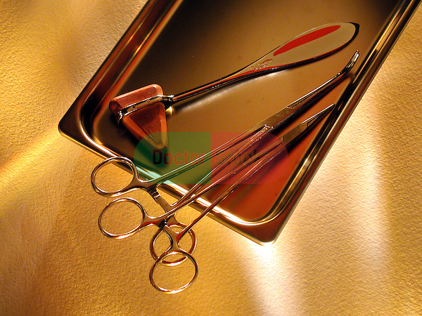 still-life of surgical tools, hemostats on stainless steel tray