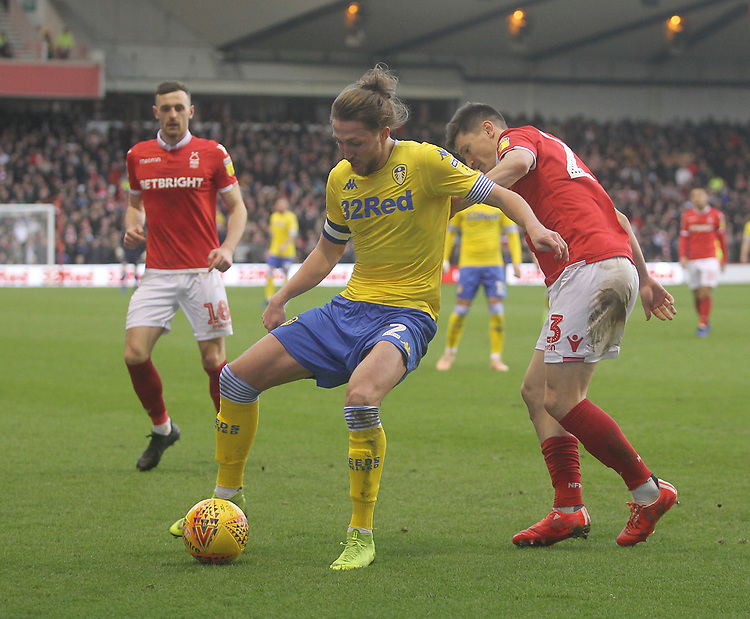 Leeds United's Luke Ayling holds of Nottingham Forest's Joe Lolley<br /> <br /> Photographer Mick Walker/CameraSport<br /> <br /> The EFL Sky Bet Championship - Nottingham Forest v Leeds United - Tuesday 1st January 2019 - The City Ground - Nottingham<br /> <br /> World Copyright © 2019 CameraSport. All rights reserved. 43 Linden Ave. Countesthorpe. Leicester. England. LE8 5PG - Tel: +44 (0) 116 277 4147 - admin@camerasport.com - www.camerasport.com