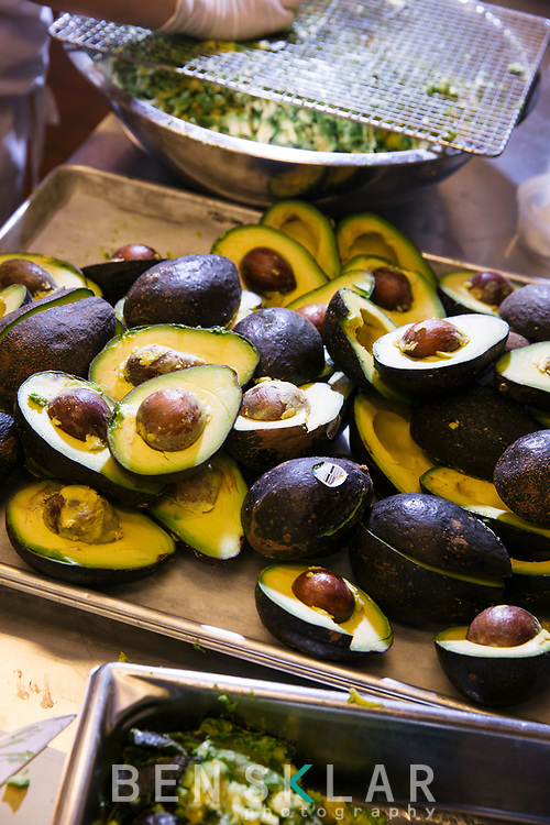 4:39pm<br /> <br /> Avocados are cut in half and squeezed for fresh guacamole throughout the day.