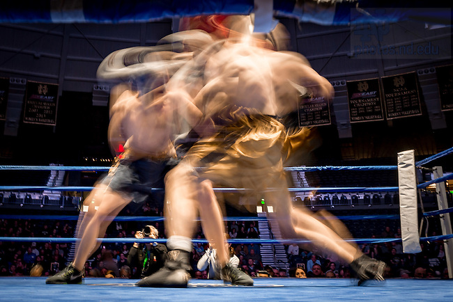 "March 3, 2017; Montana ""Louisianimal"" Giordano (blue trunks) and Jack Considine (gold trunks) fight in the 199lb. division. Considine, president of the Men's Boxing Club, won in a unanimous decision. (Photo by Matt Cashore/University of Notre Dame)"