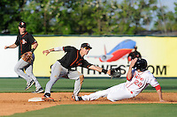Outfielder Drew Turocy (22) of the Greenville Drive steals second base as the throw eludes shortstop Adrian Marin (6) of the Delmarva Shorebirds, who twists his ankle in the process, in a game on Monday, April 29, 2013, at Fluor Field at the West End in Greenville, South Carolina. Delmarva won, 6-5 in game one of a doubleheader. (Tom Priddy/Four Seam Images)