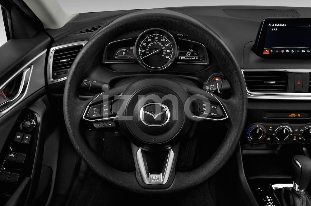 Car pictures of steering wheel view of a 2018 Mazda Mazda3 Sport 4 Door Sedan Steering Wheel