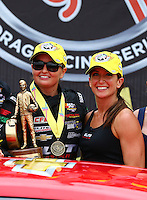 Apr 27, 2014; Baytown, TX, USA; NHRA pro stock driver Erica Enders-Stevens (left) with sister Courtney Enders celebrates after winning the Spring Nationals at Royal Purple Raceway. Mandatory Credit: Mark J. Rebilas-