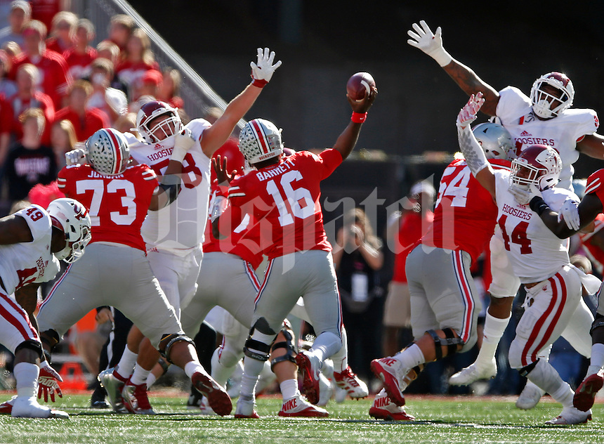 Ohio State Buckeyes quarterback J.T. Barrett (16) passes over the Indiana defense at Ohio Stadium October 8, 2016. (Dispatch photo by Eric Albrecht)