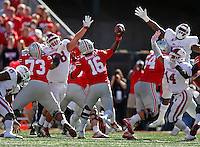 Ohio State Buckeyes quarterback J.T. Barrett (16) passes over the Indiana defense at Ohio Stadium October 8, 2016. (Dispatch photo by Eric Albrecht)