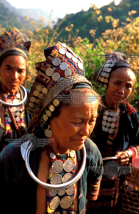 © Chris Stowers / Panos Pictures..Northern Laos..Hilltribe women with ancient French coins decorating their head gear.