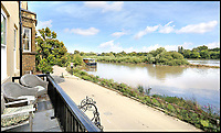 BNPS.co.uk (01202 558833)<br /> Pic: Riverhomes/BNPS<br /> <br /> Looking upriver...<br /> <br /> Buy a bit of London Pride...Red Lion House was once the pub attached to the famous Fullers brewery in Chiswick.<br /> <br /> Yours for &pound;8million - Beer fans with deep pockets will want to get their hands on this famous former pub - as it's all but attached to the historic Fullers brewery by the Thames in Chiswick.<br /> <br /> Red Lion House, on exclusive Chiswick Mall in west London, was originally built as a pub more than 300 years ago for Thomas Mawson's brewery, which went on to become Fuller's in 1845.<br /> <br /> Back in the 18th and 19th centuries, the pub would have been a bustling hive of activity with boat crews and carters as regular customers, but it is now a tranquil and elegant riverside home.<br /> <br /> It does have an incredible wine cellar with a barrelled ceiling that is perfect for hosting parties if the new owners want to play publican.