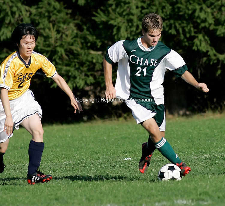 WATERBURY,  CT 05 October 2005 -100505BZ05- <br /> Storm King #2, Sung Woo Kwon, left, and Chase Collegiate #21, Drew Haverly<br /> battle for the ball during their game at Chase Collegiate Wednesday afternoon.<br /> Jamison C. Bazinet / Republican-American