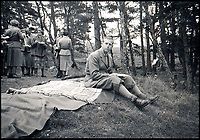 BNPS.co.uk (01202 558833)Pic:    Rowley's/BNPS<br /> <br /> Prince Philip, seated on a blanket, having a picnic near Balmoral.<br /> <br /> Two previously unknown poems by celebrated writer Daphne du Maurier have been discovered hidden inside a photograph frame.<br /> <br /> They are believed to have been penned in the late 1920s, when she was in her early 20s and an unknown in the literary world.<br /> <br /> The poems were written on a carefully folded sheet of A4 paper concealed within a 5ins high blue leather frame which contained a photo of du Maurier in a swimming costume. <br /> <br /> They were uncovered by an eagle-eyed auctioneer who has been tasked with selling an archive of du Maurier's letters and photos, which includes snaps with the Royals.