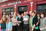 """Best Business Entry:Stack's """"Carry Out"""", Listowel won the best Busniess entry in this years St. Patrick Day parade and seen here is bernie keane presenting the cup to Elsie McGrath Foran & Matt Mooney presenting a placque to Martin Stack."""