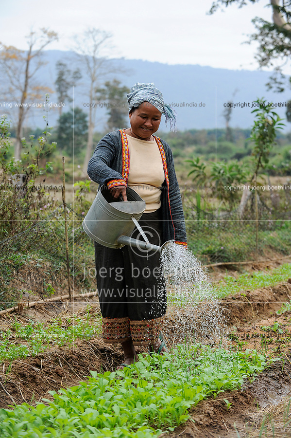 Laos, District Sang Thong,  woman cultivates vegetable field  / Laos, Farmerin baut Gemuese an, Bewaesserung mit Giesskanne