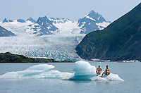 Lance Fujioka, of Hawaii, and Rhoscoe Coquia, of Seattle, cool their heels and more on an iceberg on Grewingk Glacier Lake in Kachemak Bay State Park near Homer, Alaska, in July 2009. Despite record-setting heat, the time they spent on the ice in their boxers was relatively brief.